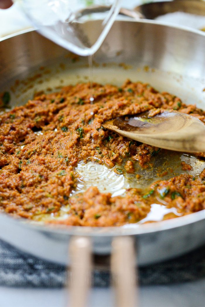 add wine to sauce and scrape pan