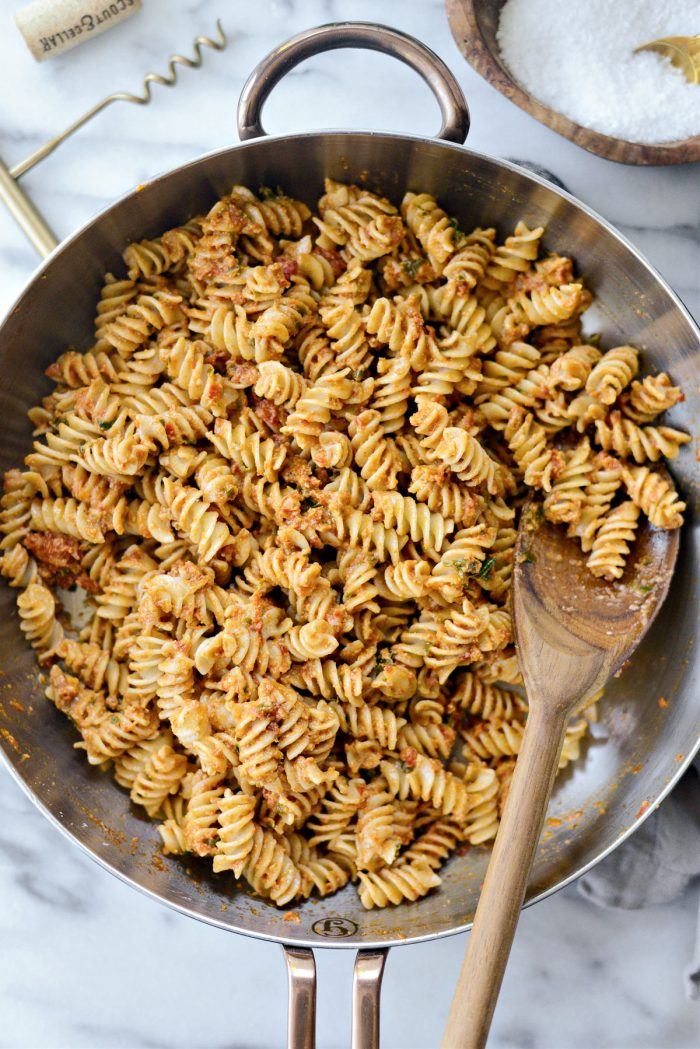 saucy pesto pasta in skillet