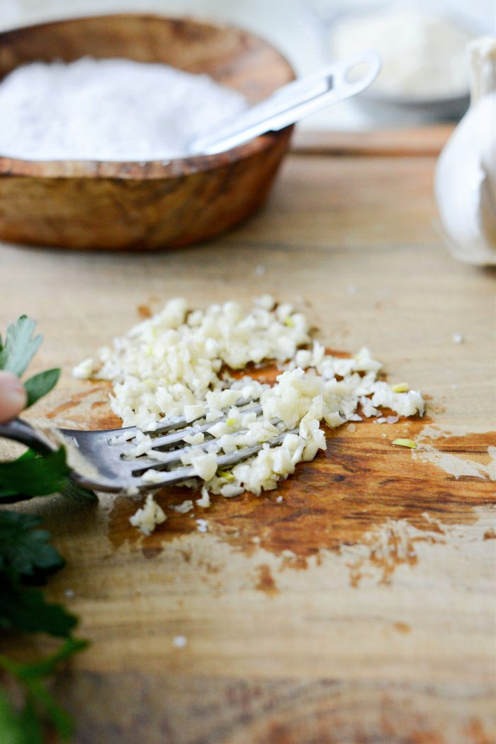 mash garlic and salt with fork