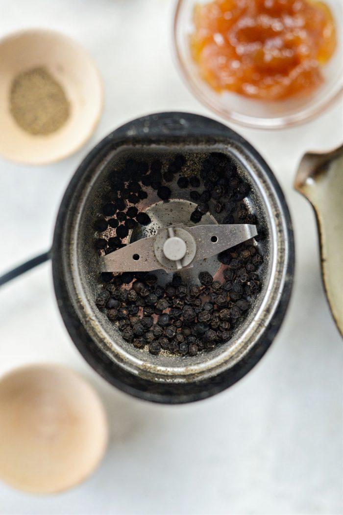 peppercorns in grinder