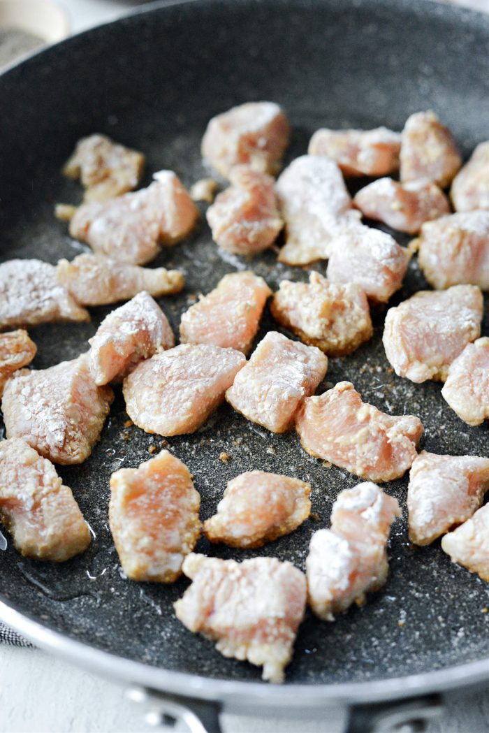 add coated chicken to hot skillet