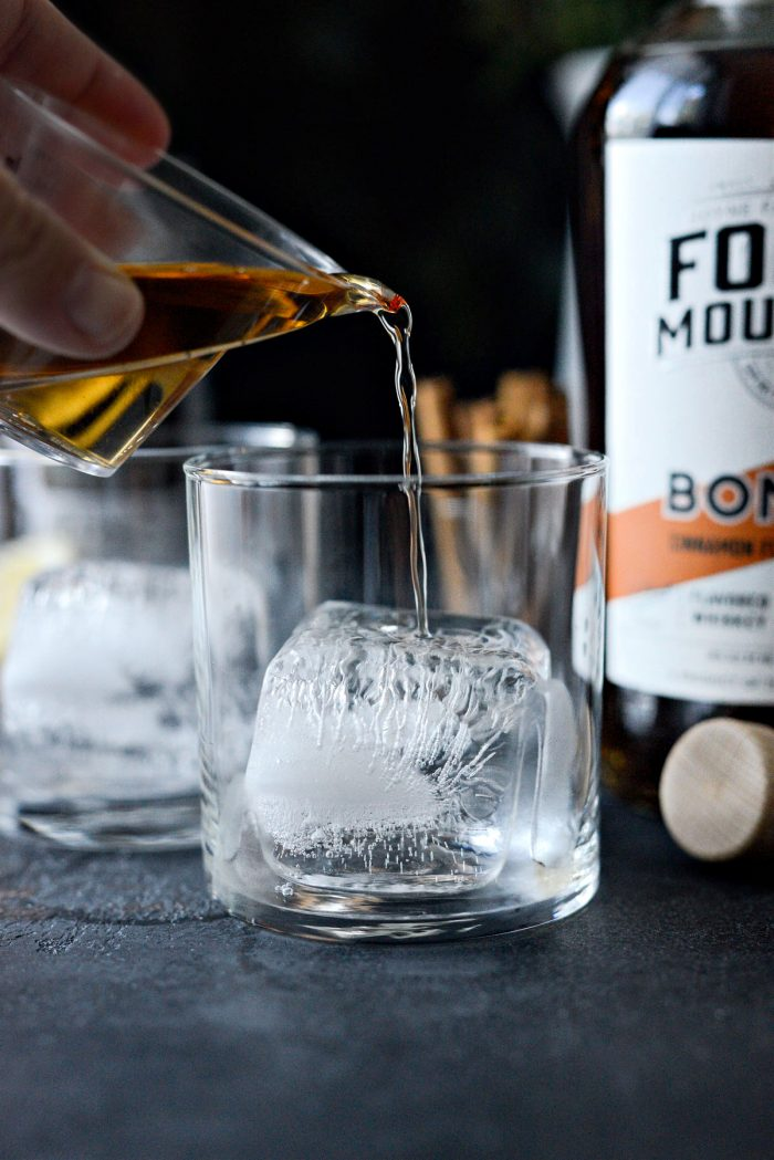 pour whiskey over ice