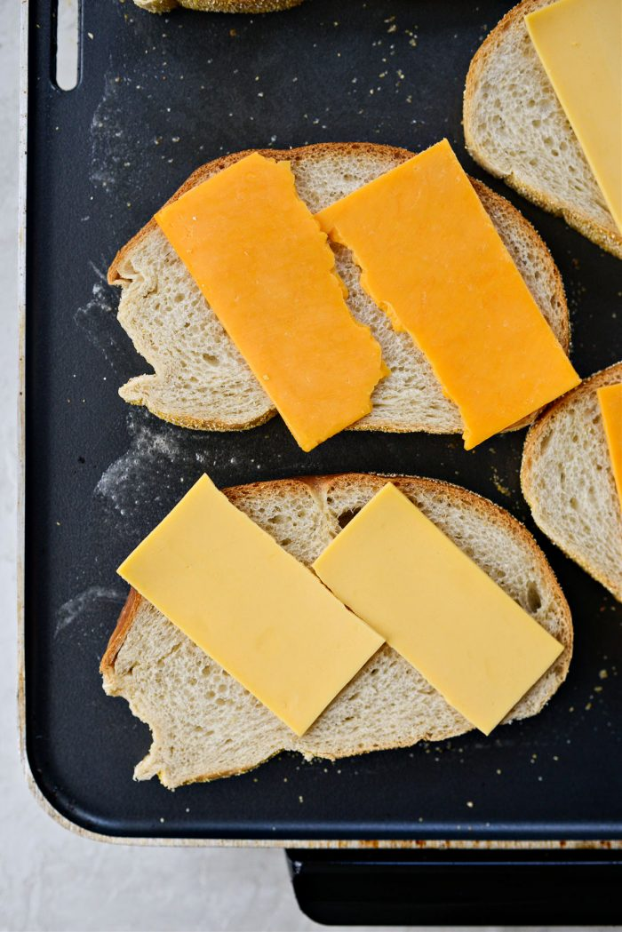 rye bread and cheese on griddle
