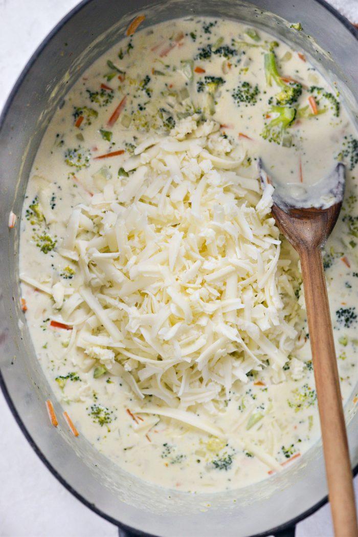 add in freshly grated cheddar
